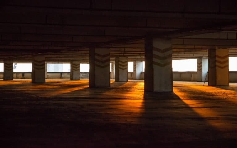parking garage with sunset light shining through