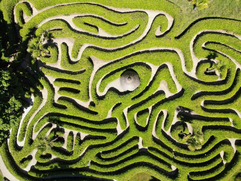 aerial shot of a maze on a large piece of lush green land