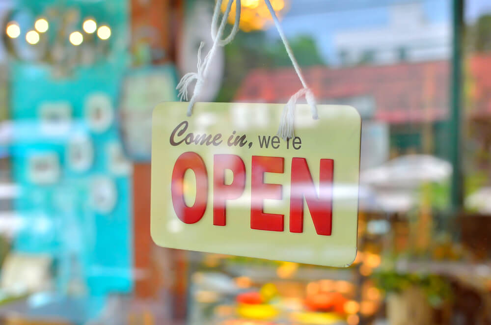 open sign hanging on a business door