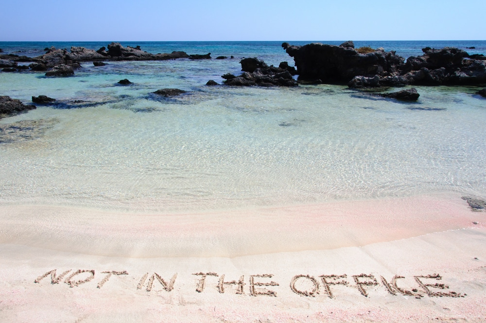 out-of-office-written-in-sand
